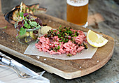 Beef tartare with herbs and gherkins