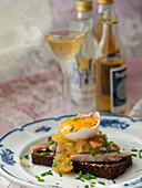Dalarömacka (bread topped with smoked fish, fennel caviar and egg yolk, Sweden)