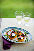 Crispy polenta canapés with rocket, olives and radishes