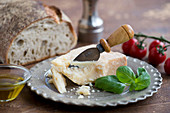 Italian arrangement with Parmesan, basil, bread, olive oil and tomatoes
