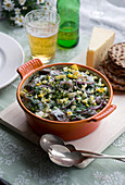 Soused herring with egg, red onions, dill and cheese in a baking dish (Scandinavia)
