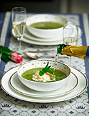 Green summer soup with champagne and cream for a wedding