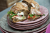 Sandwiches with tomatoes, rocket and cream cheese