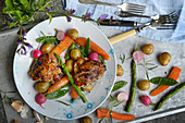 Grilled chicken with potatoes and vegetables