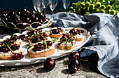 Crostini with ricotta, rosemary and balsamic cherries