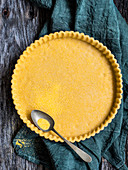 Unbaked shortcrust pastry with polenta flour