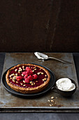 Peanut and raspberry tart