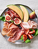 Italian cold cuts with figs and melon