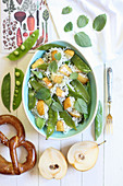 Rice salad with mangetout, pears and mint (top view)