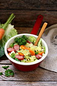 Savoy cabbage stew with carrots and smoked sausage