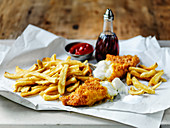 British fish and chips withy vinegar and tomato ketchup