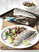 Sea bass fillets with lentils abd coriander with lime wedges