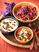 Indian salads - red cabbage and pepper Bhindi, raita okra salad, cucumber and tomato salad