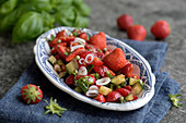Strawberry salsa with cucumber, peppers and basil