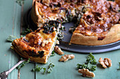 Winter kale quiche with walnuts, sliced