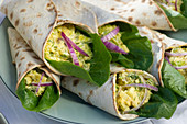 Wraps with herring salad and red onions