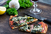 Kale pizza with pancetta and gorgonzola
