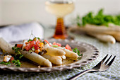White asparagus with tomatoes and brown lemon butter