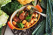 Sautéed cabbage with chorizo, gnocchi and mushrooms