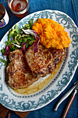 A pork chop with root vegetable purée