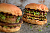 Vegetarian courgette burgers with grilled onions