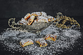 Date and marzipan pralines with icing sugar