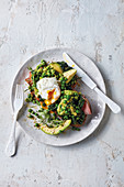 Poached eggs with peas, avocado and ham