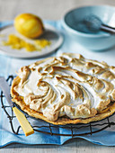 Lemon merigue pie with grated lemon zest
