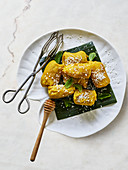 Baked bananas with honey coated in coconut