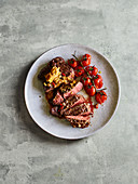 Grilled entrecote with cherry tomatoes