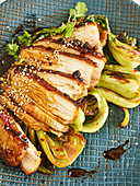 Strips of pork belly with coriander, chilli and bok choy