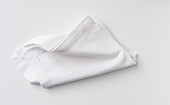 A white napkin on a white surface