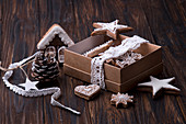 Chtistmas New Year box gift with festive gingerbread cookies and decorations