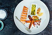 Grilled salmon with grilled carrot and sour dip