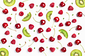 Cherry, raspberry and kiwi slices over white background