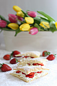 Puff pastries with cream and strawberries