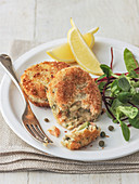 Salmon fish cakes with capers with beetroot leaves