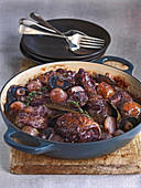 Coq au vin made with chicken, mushrooms, shallots, herbs and red wine