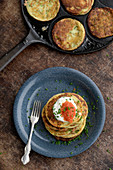 Pancakes with sour cream, chives and caviar