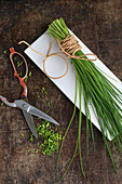 Fresh chives with a pair of scissors