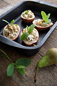 Stuffed roasted pears with feta cheese, walnuts and mint