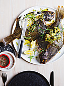 Whole-roasted flounder with caper, anchovy and herb butter