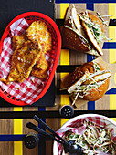Chicken schnitzel bun with cabbage and apple slaw