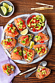 Croutons with smoked salmon and avocado tomato salsa