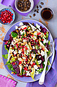 Salad with beetroot, pear, pomegranate and feta