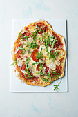 Pizza with tomatoes, cheese and rocket