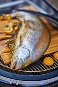 Smoked fjord trout on a grill