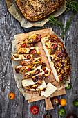 Potato focaccia with Mediterranean herbs and cherry tomatoes