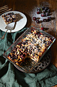Bread pudding made with croissants, cherries, and almonds