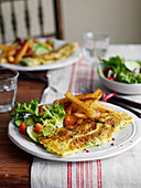Parsley omelette with lettuce and chips